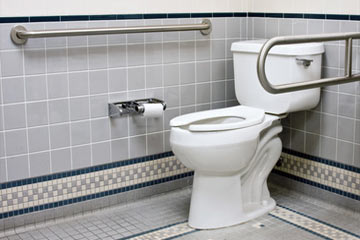 Installing a toilet grab bar or accessibility bar